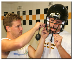 Dan Loheyde gets fitted for his helmet by Wiz